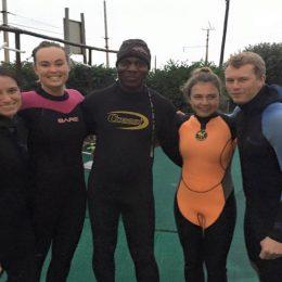 Shark diving internship team head to sea